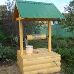 Самостоятельное оформление колодца на загородном участке
